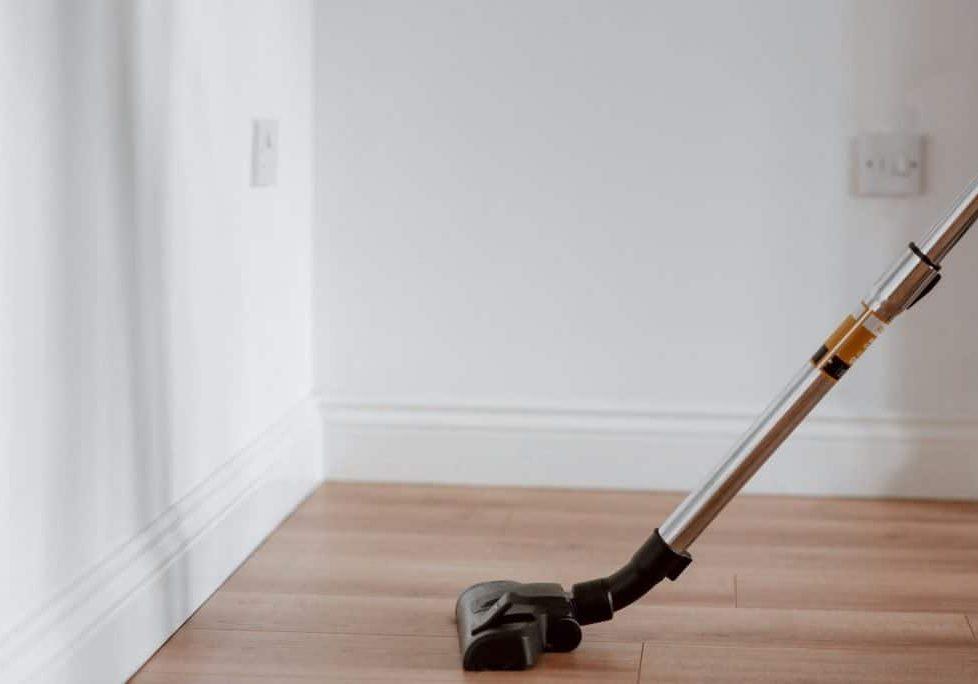 modern vacuum cleaner washing floor in flat